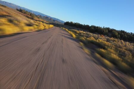Desert in California. A car racing on high speed 스톡 콘텐츠