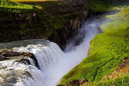 Southwest Iceland. The rumbling waterfall is fed by thawed glacial water. Gullfoss