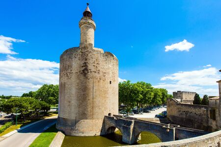 Historic tower of Constance. Powerful medieval walls and a moat with water surround the ancient port