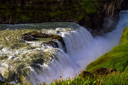 """Gullfoss """"Golden Falls"""" - the most beautiful waterfall in Iceland, on the Hvita River. Above the waterfall there is a constant haze of water. The concept of active, extreme, and photo tourism"""