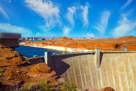 Glen Canyon Dam across the Colorado River is humanity 's great creation. The largest reservoir in the United States of artificial origin is Lake Powell. Concept of active, ecological and photo tourism
