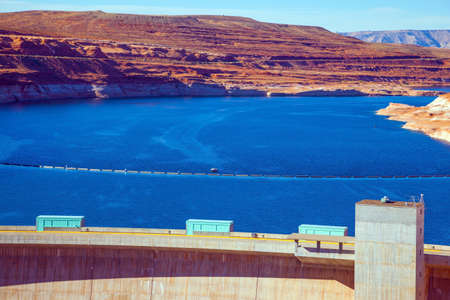The largest reservoir in the United States of artificial origin is Lake Powell. Glen Canyon Dam across the Colorado River. Best journey in life. Concept of active, ecological and photo toursm