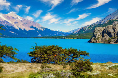 Los Glaciares is Argentina's most beautiful natural park. Huge lake with azure water and arid steppe of Patagonia. Pampas surround snow-capped mountains