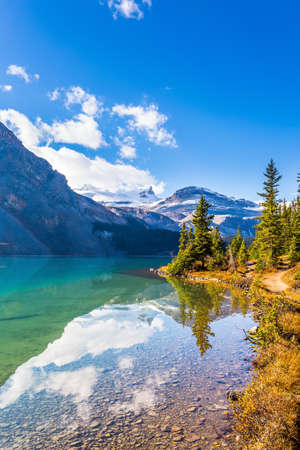 Lake Bow. Glacial lake with azure clear water. Rocky Mountains, Canada. Alberta, Icefield Parkway - a popular tourist road runs along the lakeside