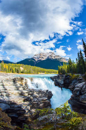 Rocky Mountains of Canada. The powerful picturesque Athabasca Falls, popular with tourists. The Athabasca River begins in Jasper Park. Travel, ecological and photo tourism concept