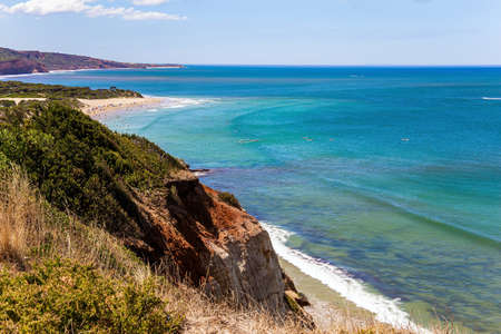 Pacific coast, sandy beach and the coastal limestone cliffs. Australia