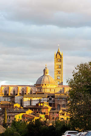 Siena Cathedral Duomo. The old city center of Siena. Sunset. Important artistic and historical monument of the Italian Gothic. Italy.