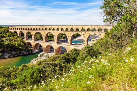 The aqueduct Pont du Gard is a three-tiered arcade. The shallow Gardon River. The Pont du Gard is the tallest Roman aqueduct. Interesting trip to France.