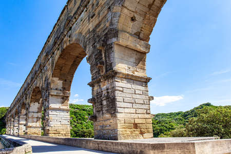 The perfectly preserved arch of the aqueduct. The Pont du Gard is the tallest surviving ancient Roman aqueduct.  Masterpiece of ancient Roman architecture