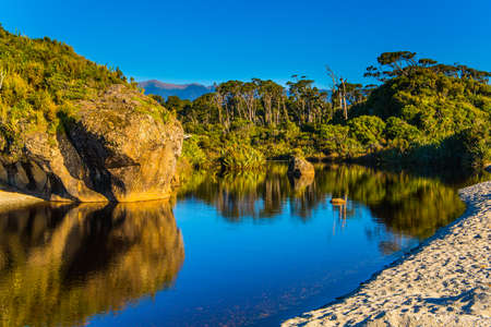 New Zealand, South Island. Travel to the ends of the world. The road to Knight's Point Lookout is an unforgettable majestic landscape. Picturesque magic reflections of overgrown shores