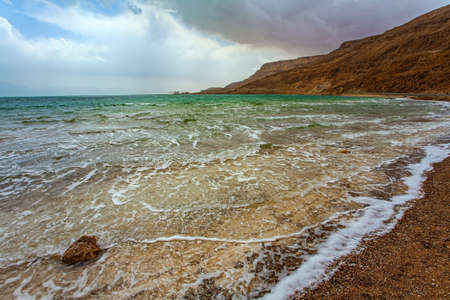 Magnificent exotic resort for treatment and relaxation. The Dead Sea is a closed salt lake. After a thunderstorm at the Dead Sea. The clouds are parting