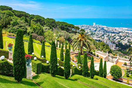 Israel. View from Mount Carmel to the international seaport of Haifa. Clear sunny day by the sea. Gorgeous colorful gardens, flower beds, cypress trees and green lawns attract tourists.