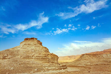 Israel. Ancient mountains and deserts around the Dead Sea. Magnificent exotic resort for treatment and relaxation. Hot afternoon in the Judean Desert. An interesting walk among picturesque hills, cliffs and gorges