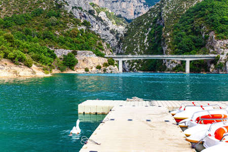 Parking for tourist catamarans. The picturesque canyon in Europe - Verdon. French Alps. The bridge connects the banks of the canyon. Фото со стока