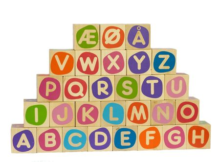 vowel: Alphabet blocks with the three special scandinavian symbols for the vowels ae, oe and aa.  Stock Photo