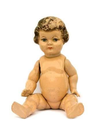 Old worn antique doll on white background. Stock Photo - 6986728