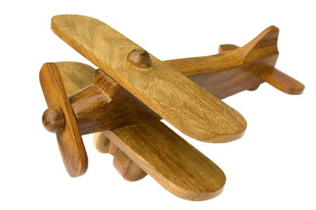 Old wooden toy plane on white background photo