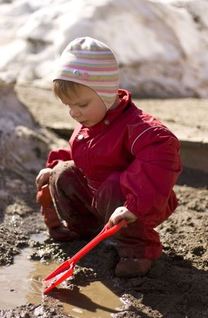 mud pit: Child playing in the mud
