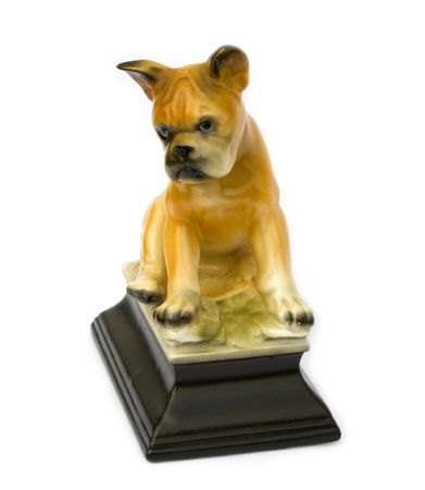 Retro vintage figurine of a boxer puppy isolated on white background photo