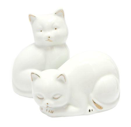 Kitsch white porcelain kitten figurines isolated on white background photo