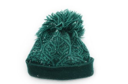 woolen: Warm woolen hat on white background covered with snowflakes