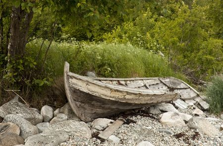 wrecked: Old wrecked wooden rowing boat on the shore.  Stock Photo