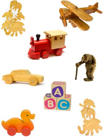 Collection of vintage and homemade wooden toys on white background.  photo