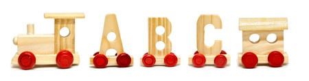 Alphabet train on white background with natural shadows photo