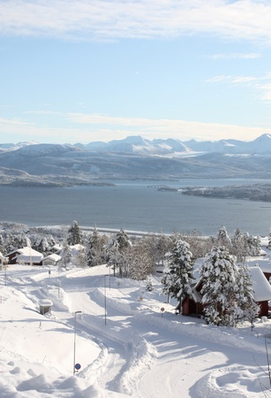 Spectacular view over a winter neighborhood, fjord, and mountains in western Norway Stock Photo - 8778110