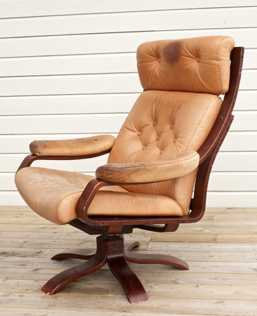 recliner: Old worn and dirty brown leather recliner chair