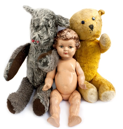 Two teddy bears and a doll on white background photo