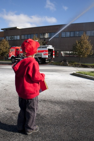 Child (3 years old) looking at a fire engine photo