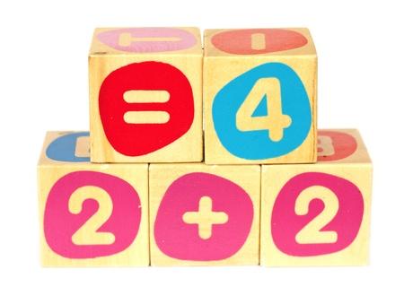 Childrens educational building bricks, with mathematical symbols photo