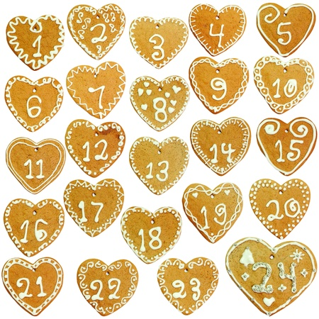 Gingerbread calendar; 24 decorated hearts photo