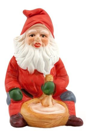 Vintage figurine of a nisse, and traditional scandinavian santa photo