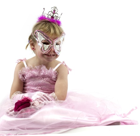 Little girl dressed up in pink for carnival photo