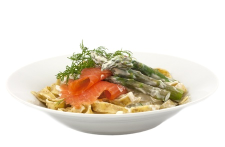 Wholemeal tagliatelle with smoked trout, asparagus and cream sauce photo