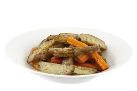 quartered: Plate full of golden fried potatoes and carrots on white