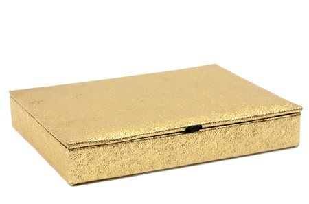 Golden shimmering gift box isolated on white background photo