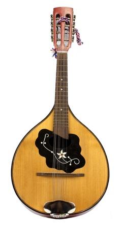 Old vintage eight string mandolin isolated on white background photo