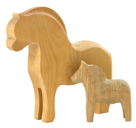 Vintage homemade horses isolated on white photo