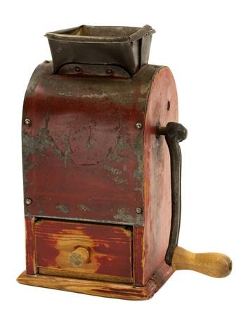 Vintage grunge manual coffee grinder on white photo
