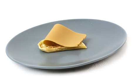 Single waffle with traditional Norwegian brown cheese on plate photo