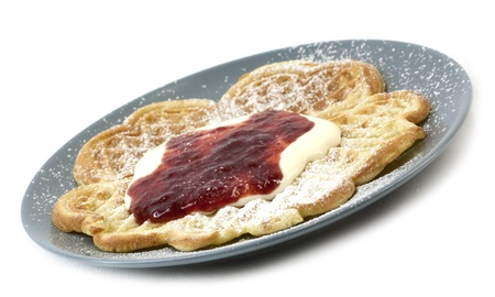 Traditional Norwegian waffles served with sourcream, jam and sugar photo
