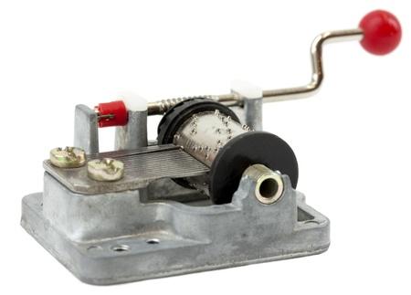 windup: Old fashioned music box isolated on white Stock Photo