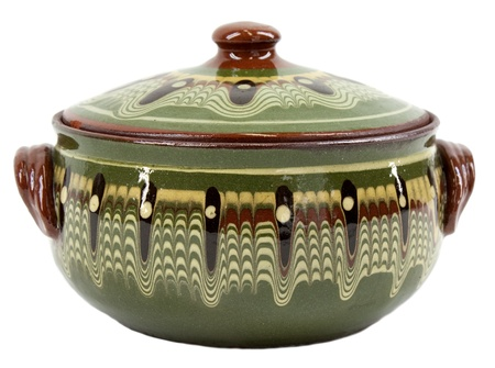 traditional goods: Traditional decorated glazed green clay pot on white Stock Photo