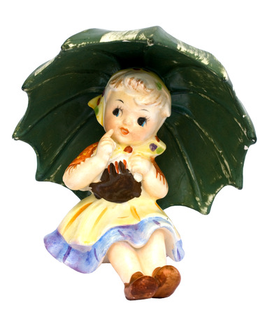 trinket: Old ceramic figurine isolated on white background