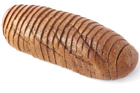 Rye bread on a white background isolated. Chopped bakery products made with various percentages of flour from grain. A loaf sliced into pieces for breakfast toast. Copy space.