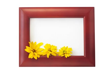 Brown wooden photo frame with yellow flowers on a white background. Hello autumn card. Home interior decor, mockup, space for text. Beautiful nature, vintage colors, minimal style concept. Copy space. Stock Photo - 130128973