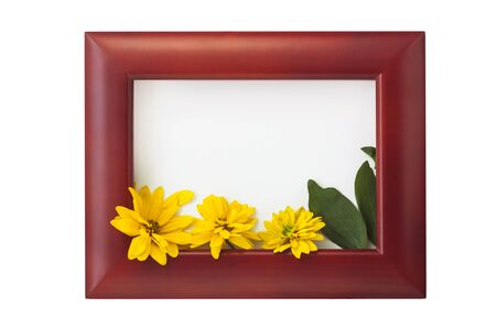 Wooden photo frame with yellow flowers and green leaves on a white background. Hello autumn card. Home interior decor, mockup, space for text. Beautiful nature, vintage colors, minimal style concept. Stock Photo